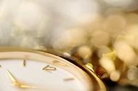Detail of a golden watch.