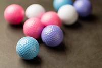 Coloured golf balls.