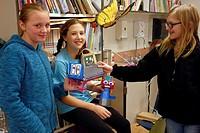 6th Grade Girls Building Robots in Art Class, Wellsville, New York, USA.