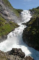 Flåm Railway (Flåmsbana, the train runs through spectacular scenery, alongside the Rallar Road, vertiginous mountainsides, foaming waterfalls, through...