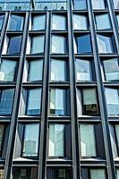New York City, Manhattan. Geometric Rectangular Pattern of Apartment Building Windows, Some with Shades Drawn.