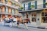 United States, Louisiana, New Orleans. Horse-drawn carriage and buildings on Royal St.