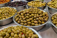 Bowls with different types of olives on the market.