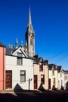 Ireland, County Cork, Cobh, Deck of Cards hillside houses and St. Colman's Cathedral.