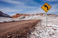 road across of Valle de la Luna (Valley of the Moon ) and salt deposited on the ground, Atacama desert. Region de Antofagasta. Chile.