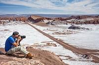 Shooting pictures, in Valle de la Luna (Valley of the Moon ) and salt deposited on the ground, near San Pedro de Atacama, Atacama desert. Region de An...
