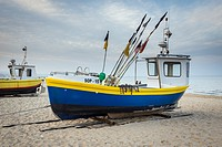 fishing boats on Baltic Sea beach in Karlikowo district in Sopot city, Poland.
