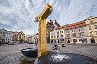 Fountain at Square of the Republic - main square in Pilsen city, Czech Republic. Old Town Hall on background (centre).