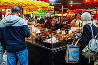People Shopping At Olivier's Bakery In Borough Market, Southwark, London, England.
