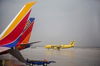 Detroit, Michigan - Spirit and Southwest Airlines planes in a rainstorm at Detroit Metro Airport.