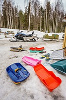 Snowmobiles and sleds, Lapland, Sweden.