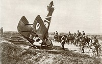 A crashed aeroplane near Cherisy, France during World War One. From The Story of 25 Eventful Years in Pictures published 1935.