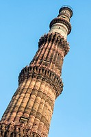 Full view of Qutub Minar, the world's largest minaret, located in New Delhi, India.
