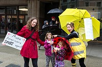 Seattle, Washington: woman dressed in costume as a bee, entertains a family along the route. The March for Science Seattle was a non-partisan rally an...