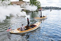 Seattle, Washington: Steamboats cross into Union Bay in the Seattle Yacht Club Boat Parade during Opening Day of Boating Season.