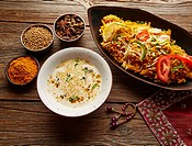Chicken Biryani indian recipe with white soup and spices.