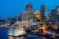 Sydney city skyline and berthed cruise ship.