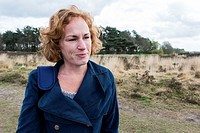 Regte Heide, Riel, Netherlands. Red headed caucasian woman strolling a nature reserve park and forrest on a free weekend afternoon.