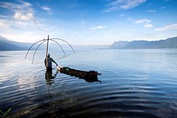 A fisherman at work using traditional system at the Lake Maninjau, West Sumatra, Indonesia.