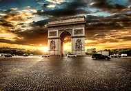 Beautiful cloudy sunset over Arc de Triomphe in Paris, France.