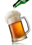 Beer pouring into mug isolated on a white background.