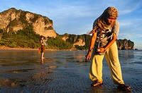 Woman at sunset with the low tide looking molluscs in Happy Island, Hat Phra Nang Beach, Railay, Krabi Province, Thailand, Southeast Asia, Asia. Hat P...