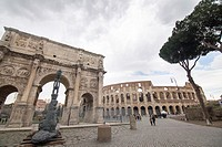 Colosseum and arch of Constantine, Rome, Italy. Colosseo in Rome, elliptical largest amphitheatre of Roman Empire ancient civilization.