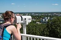 Visitor on viewing platform using telescope at IFA 2017 International Garden Festival (International Garten Ausstellung) in Berlin, Germany.