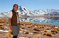 Quechua native man smiles before the camera in a wonderful Andean landscape in northern Chile. The highland lagoons.