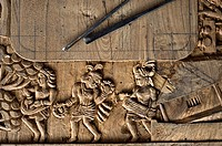 Ornate details on a wood table in a furniture workshop ( Bastar region, India). The sculpture is representing tribal musicians.
