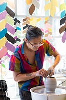 Seattle, Washington: An artist at work in the pavilion at historic Pike Place MarketFrontâ. . s grand opening. The $74 million MarketFront expansion p...