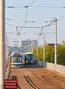 Trams passing, Nottingham, Nottinghamshire, east Midlands, England.