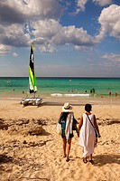 Scene from the Santa Maria del Mar beach with a catamaran in the foreground, Playas del Este, La Habana, Cuba, West Indies, Central America.