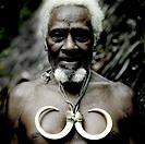 Portrait of chieftain Jean-Denis with wild pig tusks, Ambrym island, Olal, Vanuatu.