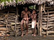 Charly Kala and his nephews from the Big Nambas tribe in front of their house, Tanna island, Yakel, Vanuatu.