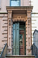 Manhattan, New York City, Partial View of a Brownstone Townhouse, Front entry Shutters partially open.