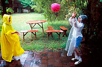 Pre-teen kids playing in the rain