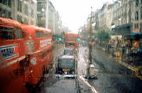 Oxford Street, London, double-decker buses in rain - photographed from the upper deck