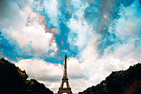 Moving clouds captured in multi-color behind the Eiffel Tower, Paris