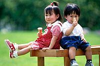 Asian children eating ice-cream