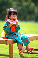 Asian girl eating water melon