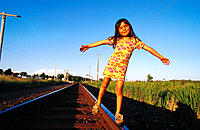Girl, 6 years old, balancing on railroad track