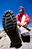Woman tying shoelaces of boots during hike, Chiricahua National Monument, Arizona, USA