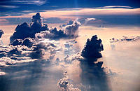 Dramatically colored and shaped clouds, seen from jet plane