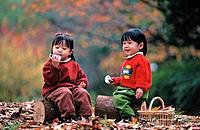 Asian children eating rice