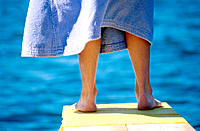Child´s legs on springboard