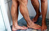 Sexy male & female legs in shower