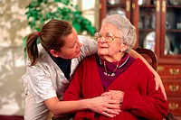 Health care worker giving support to resident in nursing home