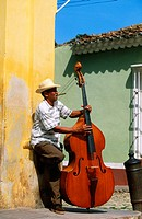 Bass player in a street of Trinidad de Cuba. Cuba