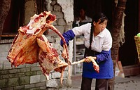 Lady butcher in Dali. Yunnan. China